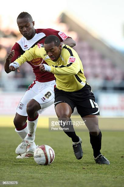 Jacques Maghoma of Burton Albion attempts to move away from Abdul Osman of Northampton Town during the Coca Cola League Two Match between 30 2010 in...
