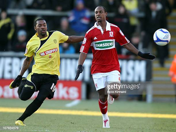 Jacques Maghoma of Burton is challenged by Seb Hines of Middlesborough during FA Cup sponsored by E.ON third round match between Burton Albion and...