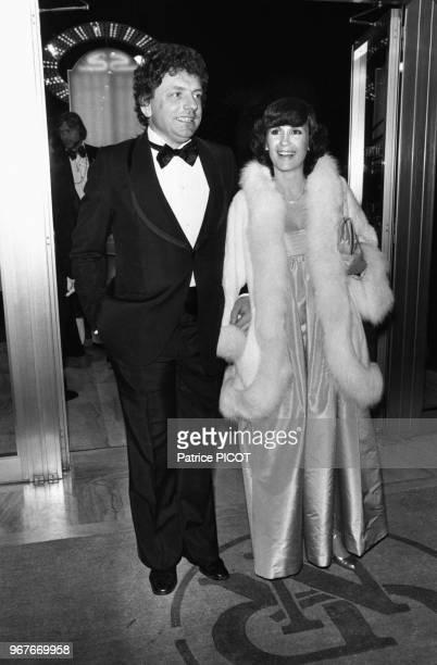 Jacques Martin et sa compagne Danièle Evenou lors d'une soirée le 18 janvier 1977 à Paris, France.