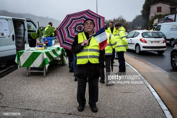 Jacques Monin a 85yearold retired man stand with other demonstrators wearing yellow vests during a protest against the rising of the fuel and oil...