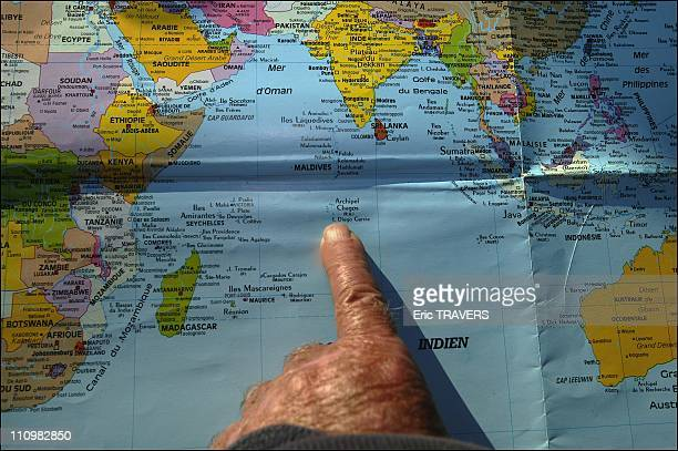 Jacques Moreau's finger showing the place where he washed up with Madeleine on Chagos Island in France on June 24 2003