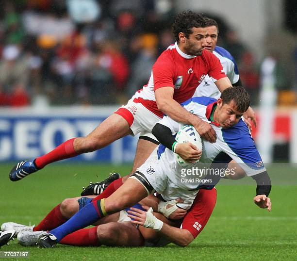 Jacques Nieuwenhuis of Namibia is tackled by Merab Kvirikashvili of Georgia during the Rugby World Cup 2007 Pool C match between Georgia and Namibia...