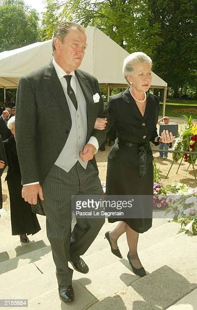 Jacques of Orleans and his wife Gersende arrive for the funeral of the Countess of Paris July 11 2003 in Dreux which is located outside of Paris...