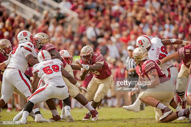 Jacques Patrick of the Florida State Seminoles makes his way through the North Carolina State Wolfpack defense during the game at Doak Campbell...