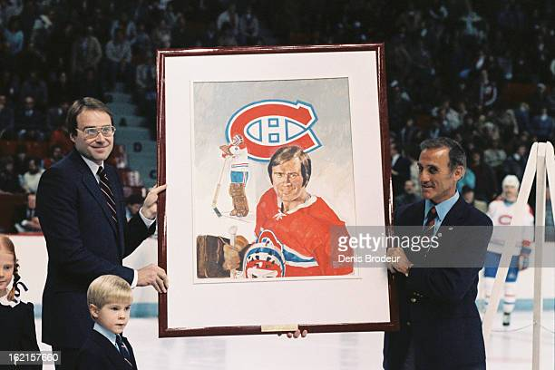 Jacques Plante presents Ken Dryden with a painting at the Montreal Forum circa 1983 in Montreal Quebec Canada