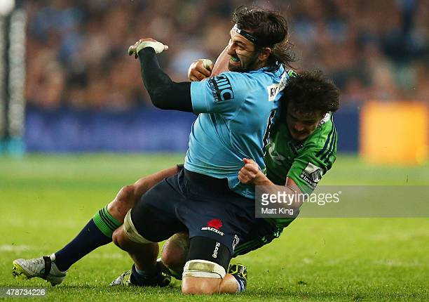 Jacques Potgieter of the Waratahs is tackled during the Super Rugby Semi Final match between the Waratahs and the Highlanders at Allianz Stadium on...