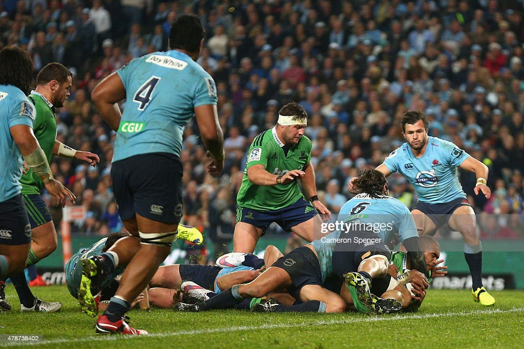 Jacques Potgieter of the Waratahs tackles Patrick Osborne of the Highlanders high as he attempts to score a try during the Super Rugby Semi Final match between the Waratahs and the Highlanders at Allianz Stadium on June 27, 2015 in Sydney, Australia.
