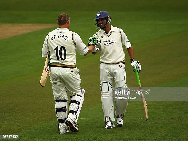 Jacques Rudolf of Yorkshire congratulates Anthony McGrath of Yorkshire on his century during the LV County Championship match between Yorkshire and...