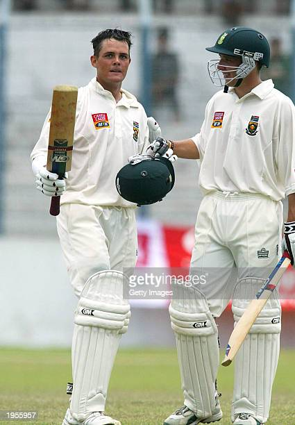 Jacques Rudolph celebrates his 200 with Boeta Dippenaar of South Africa during the 3rd day of the first test match between South Africa and...