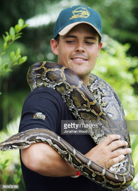 Jacques Rudolph of South Africa holds onto a Burmese Python during a visit to Australia Zoo on January 11, 2005 on the Sunshine Coast, Australia.