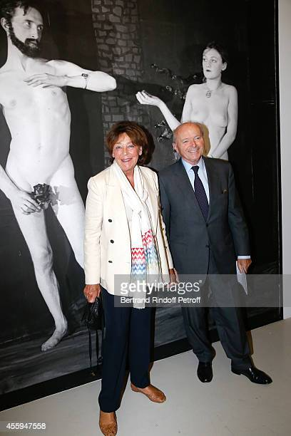 Jacques Toubon and his wife Lise pose front of the work 'Man Ray CineSketch Adam Eve' during the 'Marcel Duchamp La Peinture Meme' Exhibition Press...
