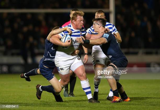 Jacques van Rooyen of Bath Rugby is tackled by Tom Curry of Sale Sharks during the Gallagher Premiership Rugby match between Sale Sharks and Bath...