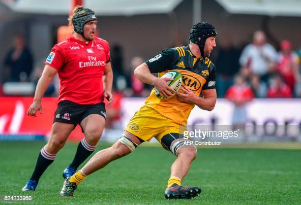 Jacques van Rooyen of the Lions and Mark Abbott of the Hurricanes vie during the Super Rugby semifinal match between Lions and Hurricanes at Ellis...