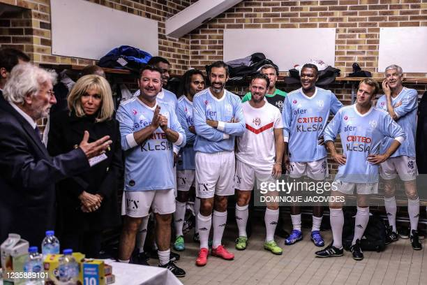 Jacques Vendroux , the general manager of the Variete Club de France, speaks as French President Emmanuel Macron in the team strip and his wife...