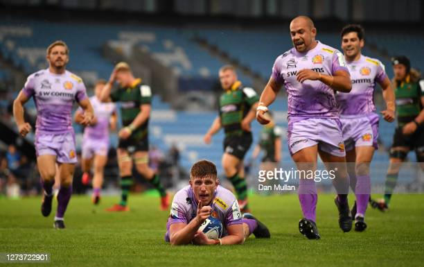 Jacques Vermeulen of Exeter Chiefs celebrates after diving over to score his side's fifth try during the Heineken Champions Cup Quarter Final match...
