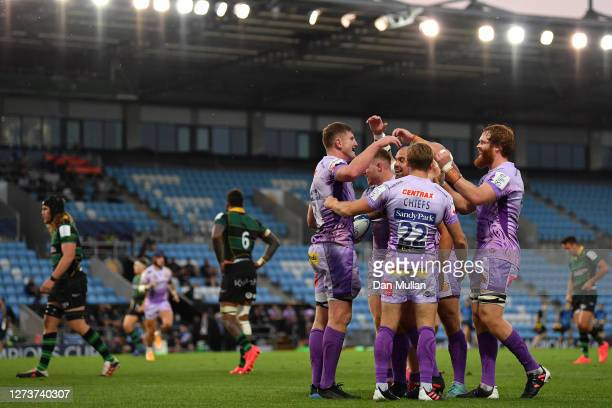 Jacques Vermeulen of Exeter Chiefs celebrates with his team mates after diving over to score his side's fifth try during the Heineken Champions Cup...