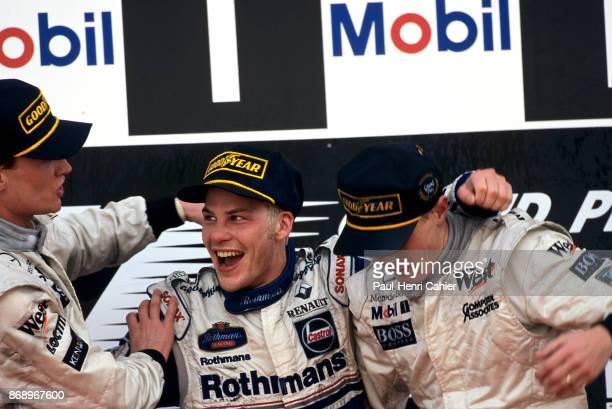 Jacques Villeneuve David Coulthard Mika Hakkinen Grand Prix of Europe Circuito de Jerez 26 October 1997 Jacques Villeneuve on the winners podium in...