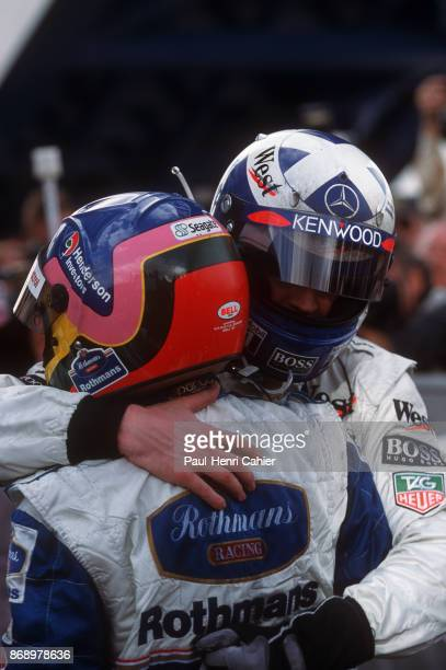 Jacques Villeneuve David Coulthard WilliamsRenault FW19 Grand Prix of Europe Circuito de Jerez 26 October 1997 Jacques Villeneuve being hugged and...
