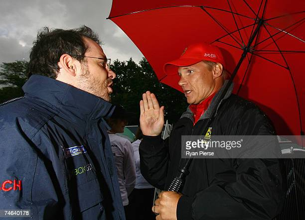 Jacques Villeneuve of Canada and Team Peugeot speaks to Mika Salo of Finland and the Risi Competizione Team at the Drivers Parade in Le Mans town...
