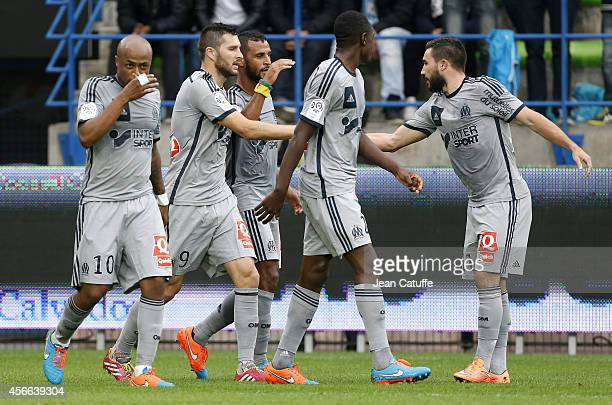 JacquesAlaixys Romao celebrates his goal with AndrePierre Gignac and Romain Alessandrini of OM during the French Ligue 1 match between Stade Malherbe...