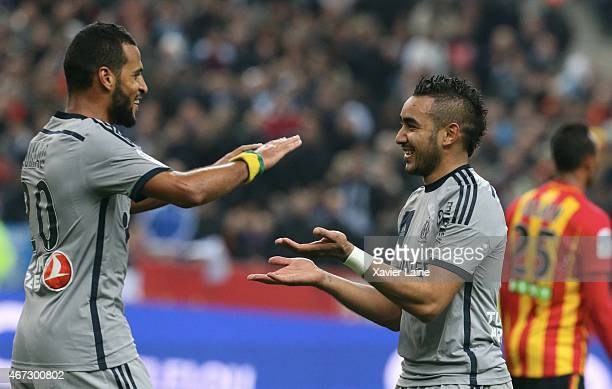 JacquesAlaixys Romao of Olympique de Marseille celebrates his goal with Dimitri Payet during the French Ligue 1 between RC Lens and Olympique de...