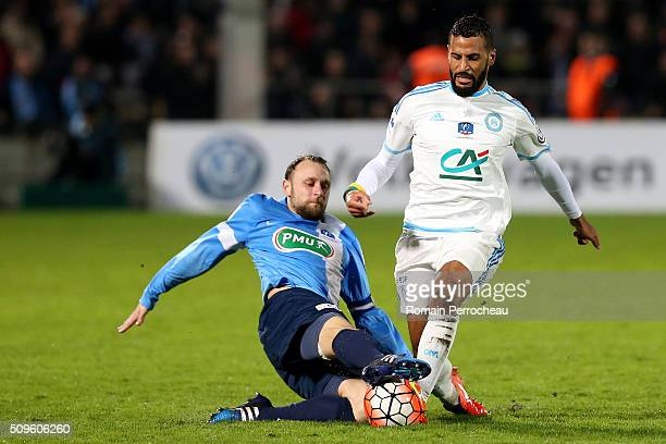 JacquesAlaixys Romao of Olympique de Marseille is tackled byJimmy Burgho of Trelissac FC during the French Cup match between Trelissac FC and...