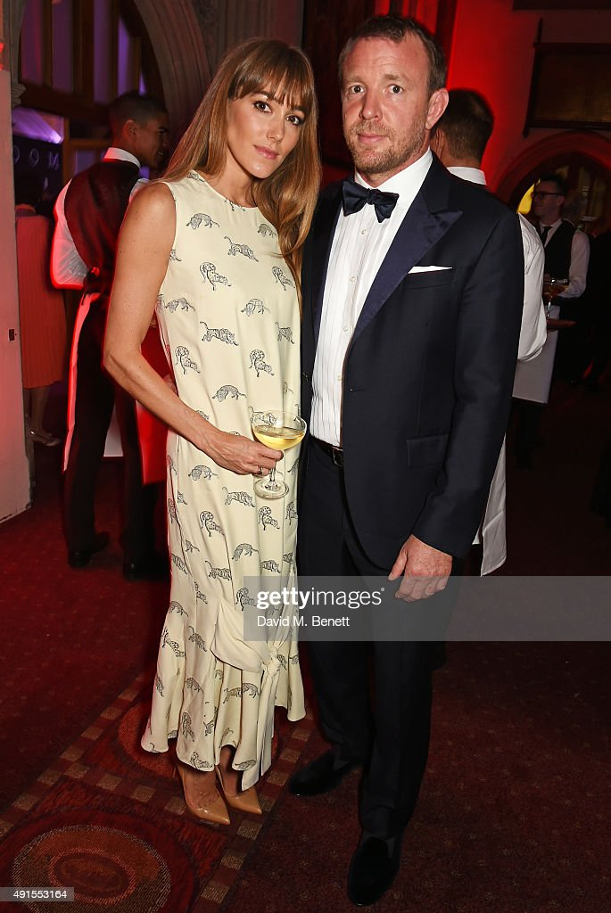 Jacqui Ainsley (L) and Guy Ritchie attend a cocktail reception at the BFI Luminous Fundraising Gala in partnership with IWC and crystals by Swarovski at The Guildhall on October 6, 2015 in London, England.