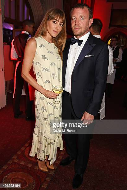 Jacqui Ainsley and Guy Ritchie attend a cocktail reception at the BFI Luminous Fundraising Gala in partnership with IWC and crystals by Swarovski at...