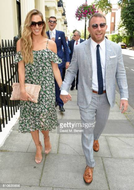 Jacqui Ainsley and Guy Ritchie attend Piers Adam and Sophie Vanacore's wedding at St John's Church on July 7 2017 in London England