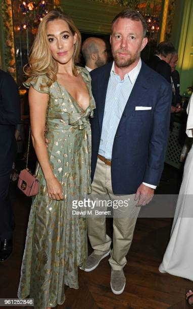 Jacqui Ainsley and Guy Ritchie attend the Annabel's x Dior dinner on May 21 2018 in London England