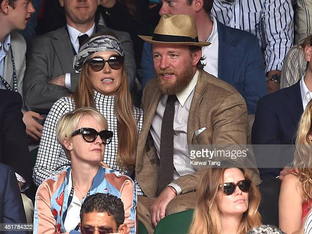 Jacqui Ainsley and Guy Ritchie attend the mens singles final between Novak Djokovic and Roger Federer on centre court during day thirteen of the...