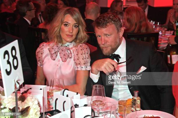 Jacqui Ainsley and Guy Ritchie attend the the GQ Men Of The Year Awards 2019 in association with HUGO BOSS at the Tate Modern on September 3 2019 in...