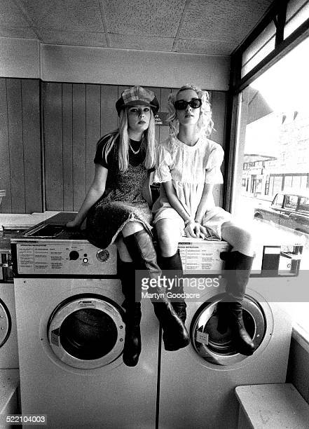 Jacqui Blake and Carrie Askew of Shampoo pose for portrait session on in a laundrette near Tower Bridge London United Kingdom 1993