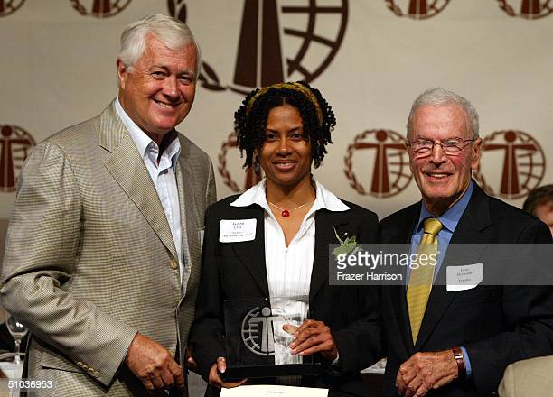 Jacqui Clay writer from the Bernie Mac Show accepts her awards from writer Allan Burns and director Gene Reynolds at The Humanitas Prize Awards at...