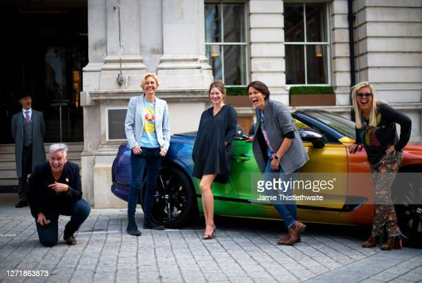 """Jacquie Lawrence, Heather Peace, Patricia Potter, Samantha Grierson and Pippa Dale pose with the rainbow Bentley during the """"Henpire"""" podcast launch..."""
