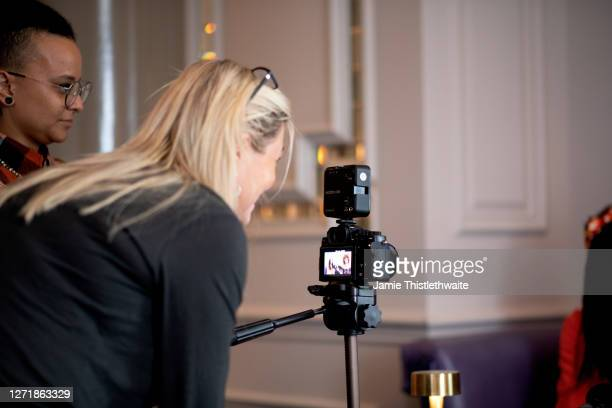 """Jacquie Lawrence lines up a shot for the on-camera interviews during the """"Henpire"""" podcast launch event at Langham Hotel on September 10, 2020 in..."""