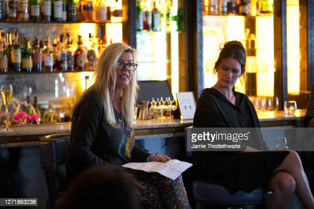 """Jacquie Lawrence reads out statistics of Lesbian women in Film and Television on the Cast and Crew panel during the """"Henpire"""" podcast launch event at..."""
