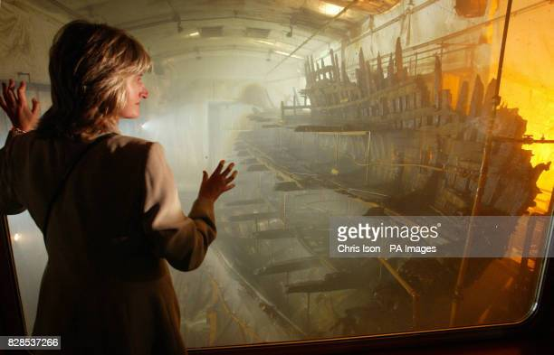 Jacquie Shaw of the Mary Rose Trust surveys the hulk of the famous Tudor warship as it sits in an atmospherically controlled dry dock in Portsmouth's...