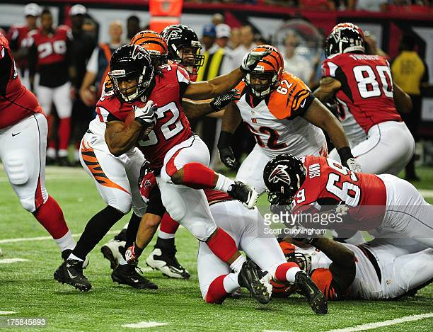Jacquizz Rodgers of the Atlanta Falcons carries the ball against the Cincinnati Bengals at the Georgia Dome on August 8 2013 in Atlanta Georgia