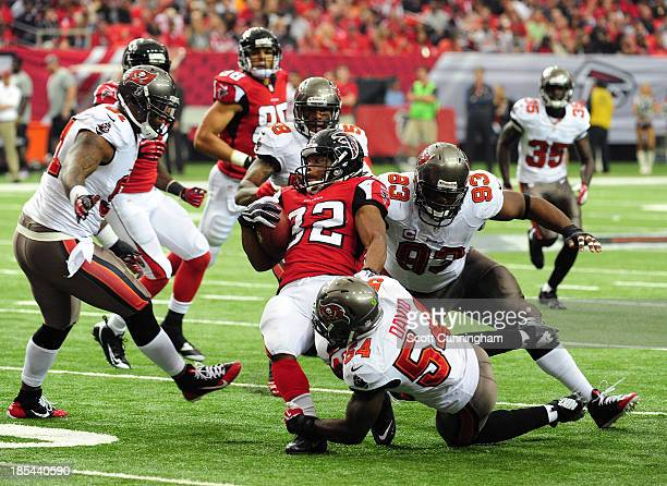 Jacquizz Rodgers of the Atlanta Falcons is tackled by Lavonte David and Gerald McCoy of the Tampa Bay Buccaneers at the Georgia Dome on October 20...