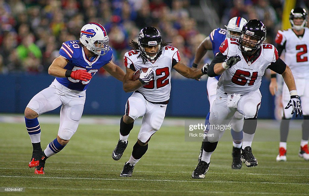 Jacquizz Rodgers #32 of the Atlanta Falcons runs against Kiko Alonso #50 of the Buffalo Bills at Rogers Centre on December 1, 2013 in Toronto, Ontario. Atlanta won 34-31 in overtime.