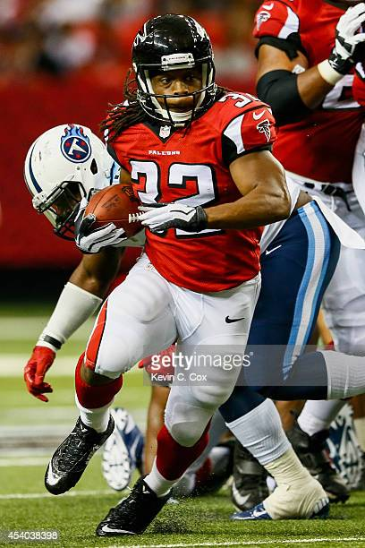 Jacquizz Rodgers of the Atlanta Falcons runs the ball in the first half of a preseason game against the Tennessee Titans at the Georgia Dome on...