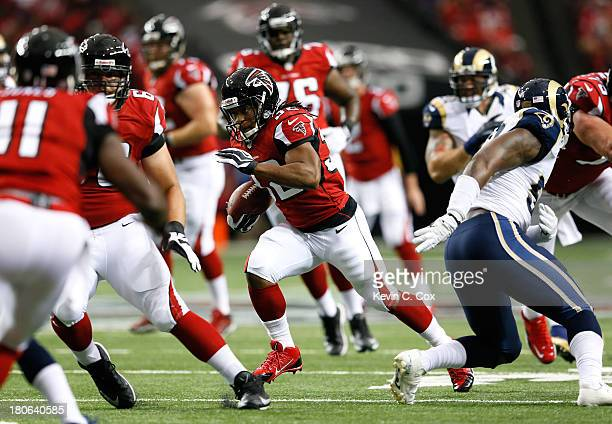 Jacquizz Rodgers of the Atlanta Falcons rushes against the St Louis Rams at Georgia Dome on September 15 2013 in Atlanta Georgia