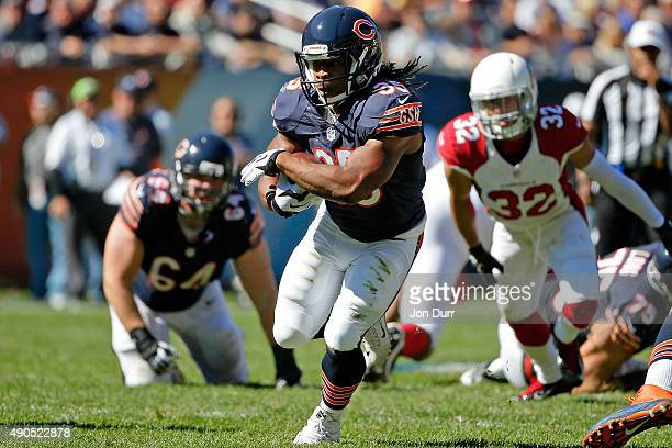 Jacquizz Rodgers of the Chicago Bears runs against the Arizona Cardinals during the third quarter at Soldier Field on September 20 2015 in Chicago...