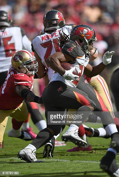 Jacquizz Rodgers of the Tampa Bay Buccaneers carries the ball against the San Francisco 49ers during the first quarter of an NFL football game at...