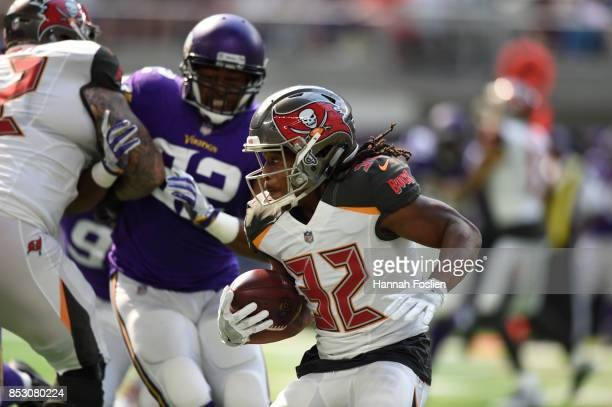 Jacquizz Rodgers of the Tampa Bay Buccaneers carries the ball in the first half of the game against the Minnesota Vikings on September 24 2017 at US...