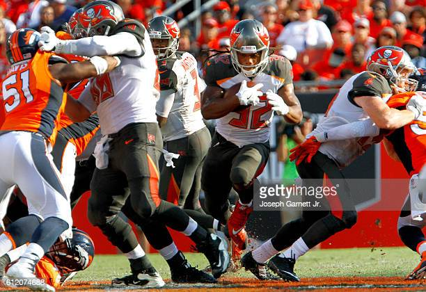 Jacquizz Rodgers of the Tampa Bay Buccaneers finds a lane in which to run in the first quarter of a game against the Denver Broncos at Raymond James...