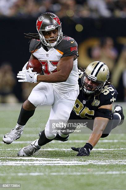 Jacquizz Rodgers of the Tampa Bay Buccaneers runs past Tyeler Davison of the New Orleans Saints during a game at the MercedesBenz Superdome on...