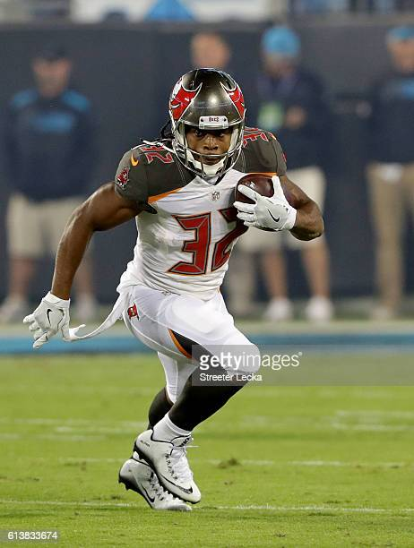 Jacquizz Rodgers of the Tampa Bay Buccaneers runs the ball against the Carolina Panthers in the 1st quarter during their game at Bank of America...