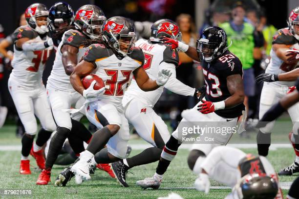 Jacquizz Rodgers of the Tampa Bay Buccaneers runs the ball during the first half against the Atlanta Falcons at MercedesBenz Stadium on November 26...